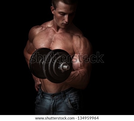 Man with a bar weights in hands training. Bodybuilding - stock photo