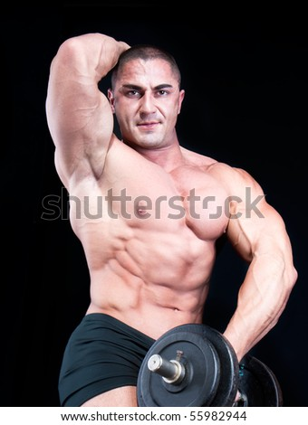 Man  with a bar weights in hands training, isolated on black - stock photo