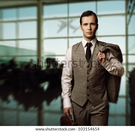 Man with a briefcase in an airport - stock photo