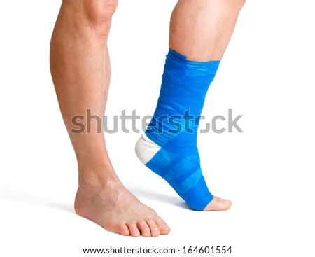 Man with a broken leg with  bandage on a white background  - stock photo