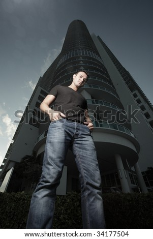 Man with a building in the background - stock photo
