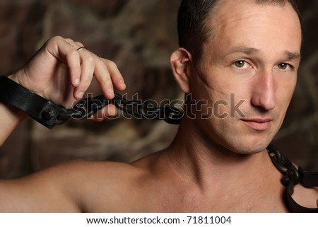 Man with a chains hands. - stock photo