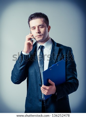 man with a clipboard talking on the phone