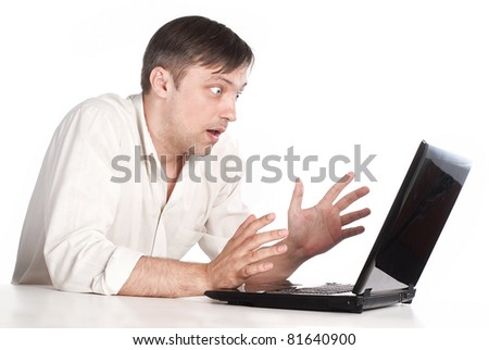 man with a computer on a white