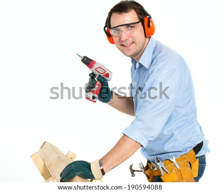man with a drill on a white background - stock photo