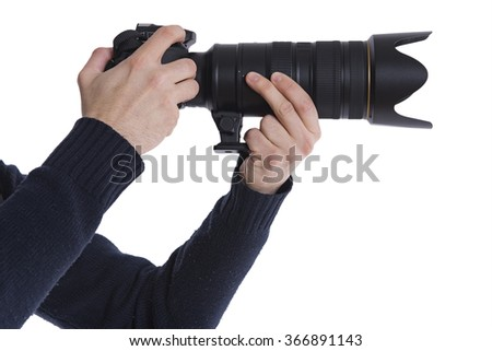 Man with a DSLR camera and a big telephoto lens.