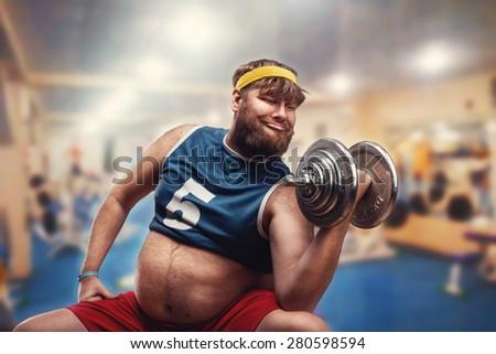 Man with a dumbbell - stock photo