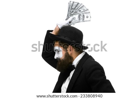 Man with a face mime dancing with money isolated on a white background. concept concept love of money, happiness from money luck - stock photo