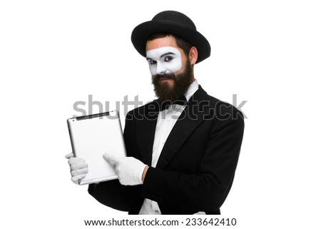 Man with a face mime working on a laptop isolated on a white background. concept concept of presentation in business