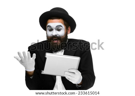 Man with a face mime working on a laptop isolated on a white background. concept concept of  good luck and joy