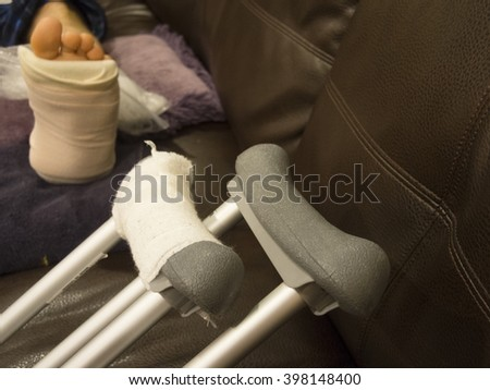 Man with A Fractured Ankle Sleeping on Couch - stock photo