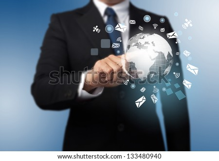 man with a global technology background with the planet Earth - stock photo