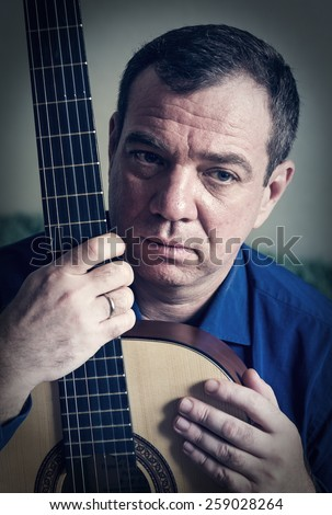Man with a guitar. - stock photo