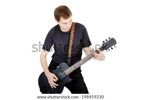 Man with a guitar on a white background. Performer with an electric guitar