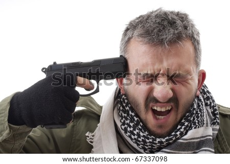 Man with a gun on his hand, suicide concept - stock photo
