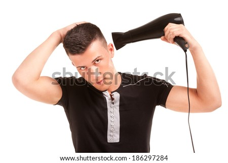 man with a hair dryer - stock photo