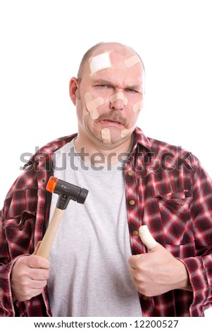 Man with a hammer and covered in bandaids - stock photo