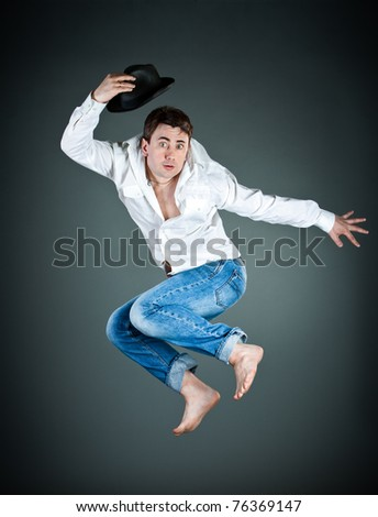 man with a hat in a jump on a dark background - stock photo