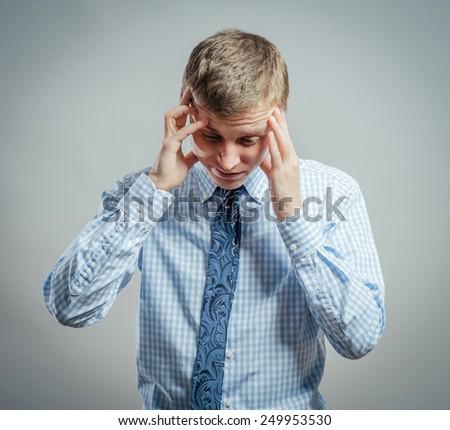 Man with a headache - stock photo