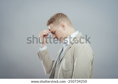 Man with a headache or problem - stock photo