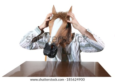 man with a horse's head mask - stock photo