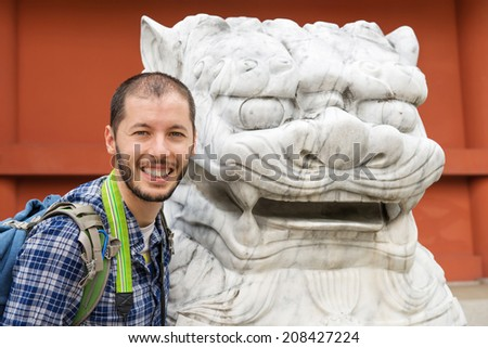 Man with a japanese stone dragon