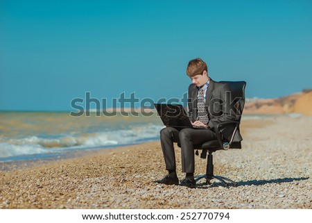 man with a laptop outdoors - stock photo