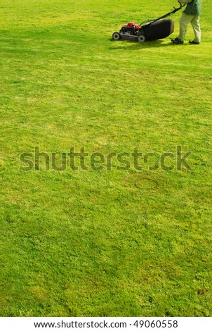 man with a lawn mower - stock photo