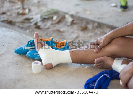 man with a leg wound,in sport game. (leg, broken, accident) - stock photo