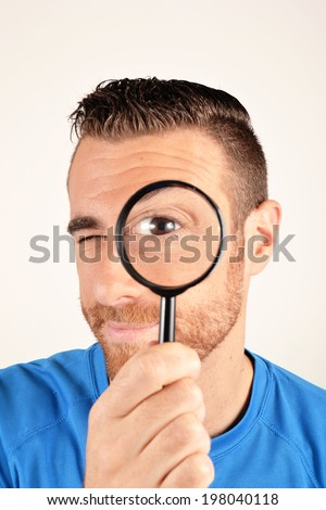 Man with a magnifier - stock photo
