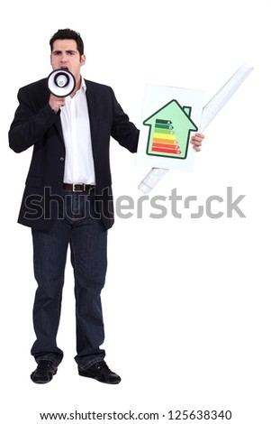 Man with a megaphone and energy rating card - stock photo