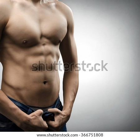 man with a naked torso - stock photo