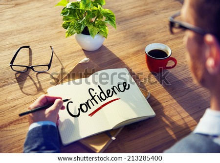 Man with a Note and a Single Word Confidence - stock photo