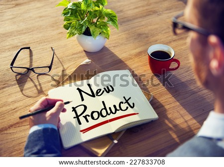 Man with a Note and a Word New Product - stock photo