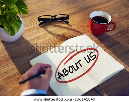 Man with a Note Pad and About-Us Concepts - stock photo