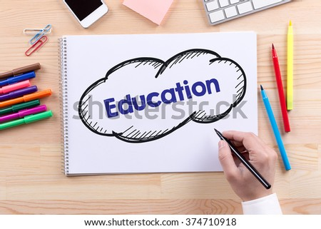 Man with a Notepad written Education Concept - stock photo