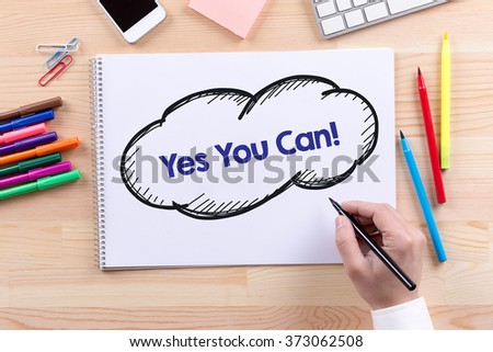 Man with a Notepad written Yes You Can! Concept - stock photo