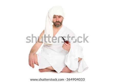 Man with a pipe in the sauna dress. From a series of Russian bath.