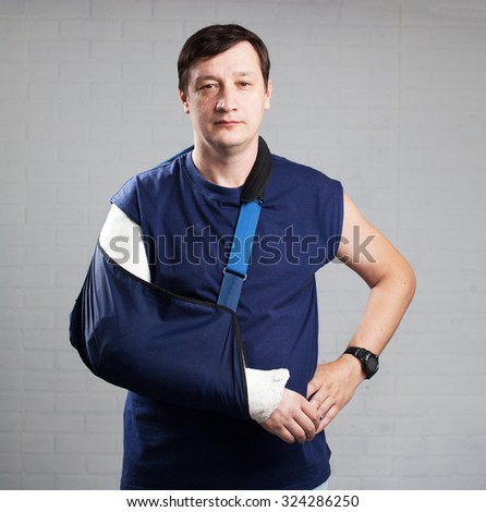 Man with a plaster. Broken arm, shoulder. Injury