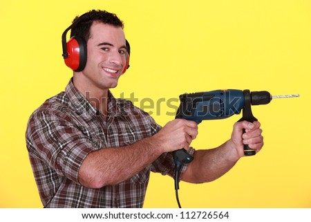 Man with a power drill - stock photo