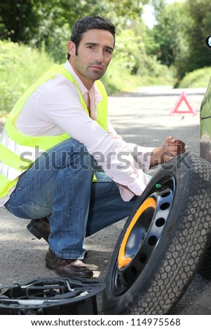 Man with a puncture - stock photo