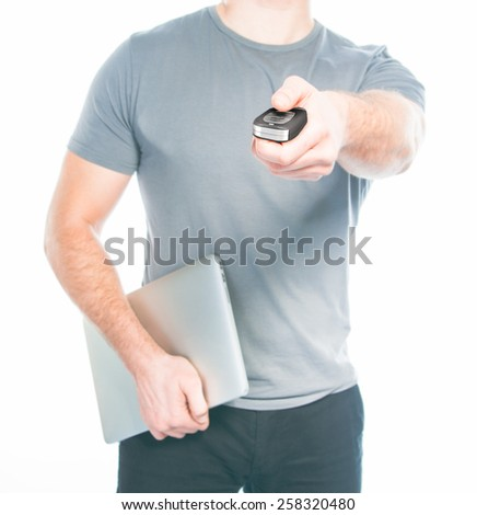 Man with a remote control from the car in the hands. High resolution. - stock photo