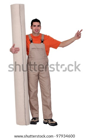 Man with a roll of carpet