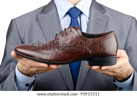 Man with a selection of shoes