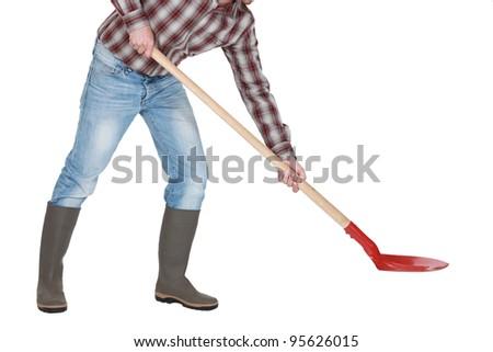 Man with a shovel - stock photo