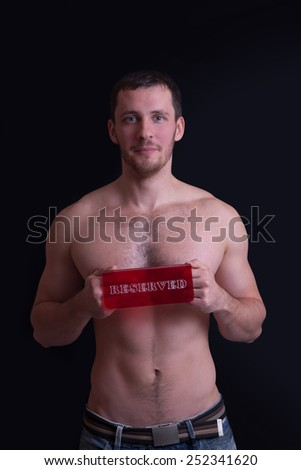 Man with a sign reserve in his hands - stock photo