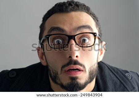 Man with a surprised facial expression, Surprise expression  - stock photo