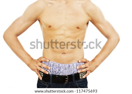 Man with a toned muscular body. Isolated on a white background