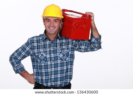 Man with a toolbox on his shoulder - stock photo