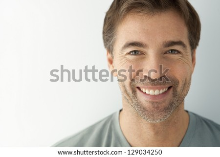 Man with a toothy smile looking at camera. This photography was made with a professional model and  others professionals to reach this quality from a raw. - stock photo